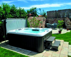Sundance Spas hot tub installed in a backyard.