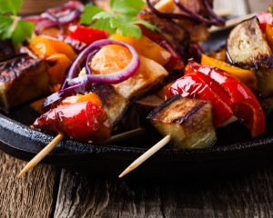 Vegetable skewers on a plate.