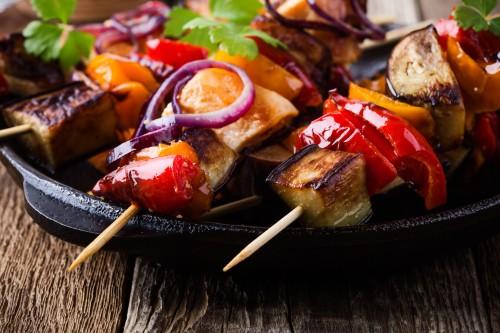 Vegetable skewers on a plate.
