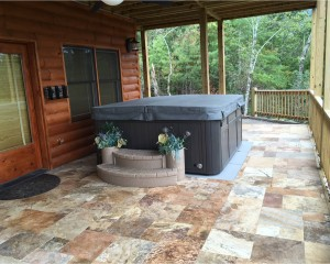 Outdoor hot tub with a cover on it.