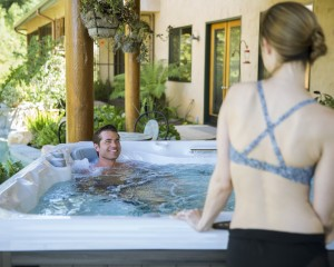 woman and man using a hot tub