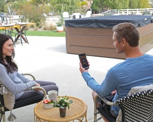 Man and woman using SmartTub System.