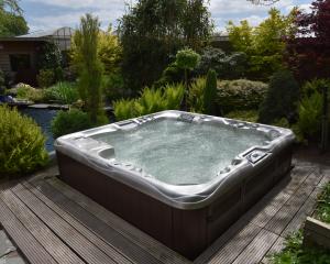 Outdoor Sundance Spas hot tub on a patio.