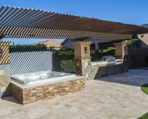 Sundance Spas outdoor installation with a BBQ